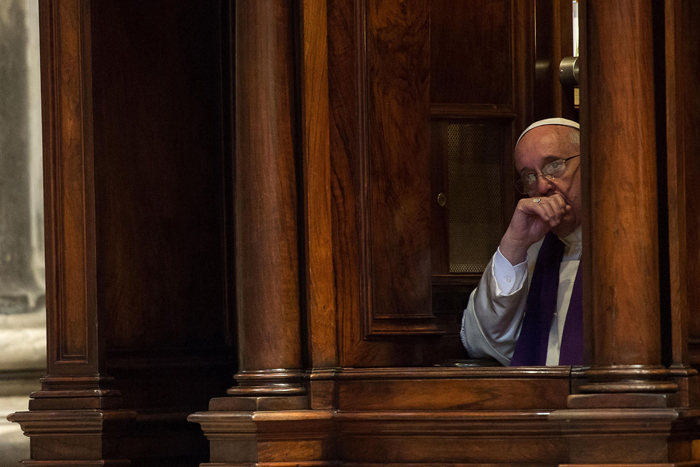 Pope Francis hears confession during a penitential liturgy in St. Peter's Basilica at the Vatican March 28. Pope Francis surprised his liturgical adviser by going to confession during the service. (CNS photo/L'Osservatore Romano via Reuters) (March 31, 2014) See POPE-PENANCE March 28, 2014.