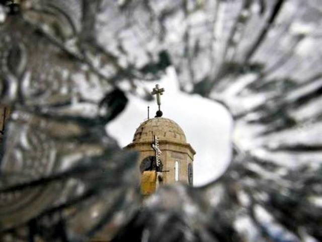 Church-seen-through-bullet-hole-in-glass-Muzaffar-SalmanAssociated-Press-640x480